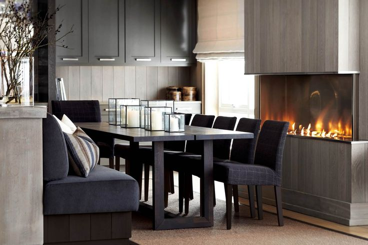 ~ love the table and banquette. Candles in the glass boxes in different sizes create nice display~