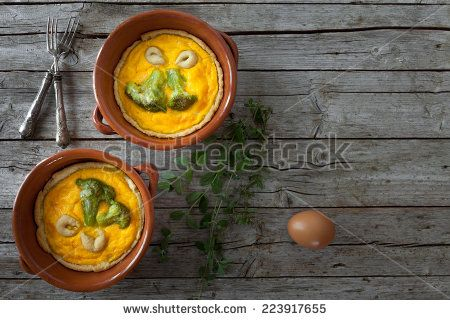 #Overhead shot of #mini #pies with #broccoli, #cheddar #cheese and #saffron. - #stockphoto #Shutterstock