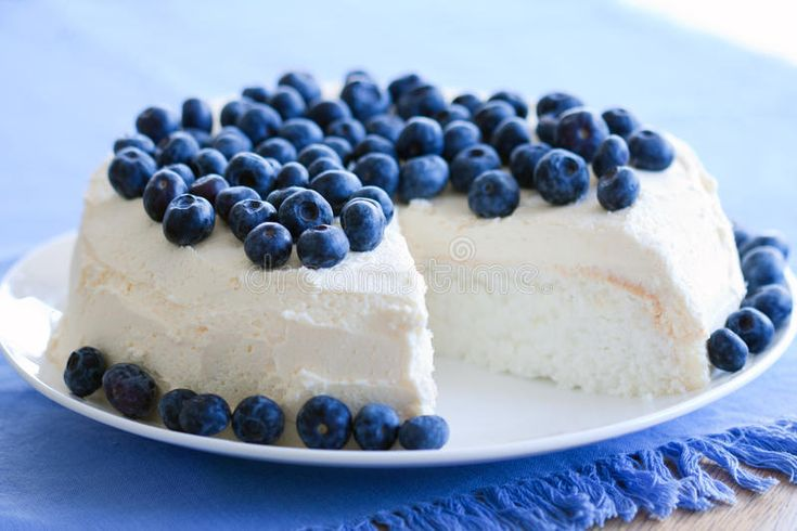 Photo about Angel food cake decorated with fresh blueberries and cream. Image of blueberries, gourmet, fresh - 18578527
