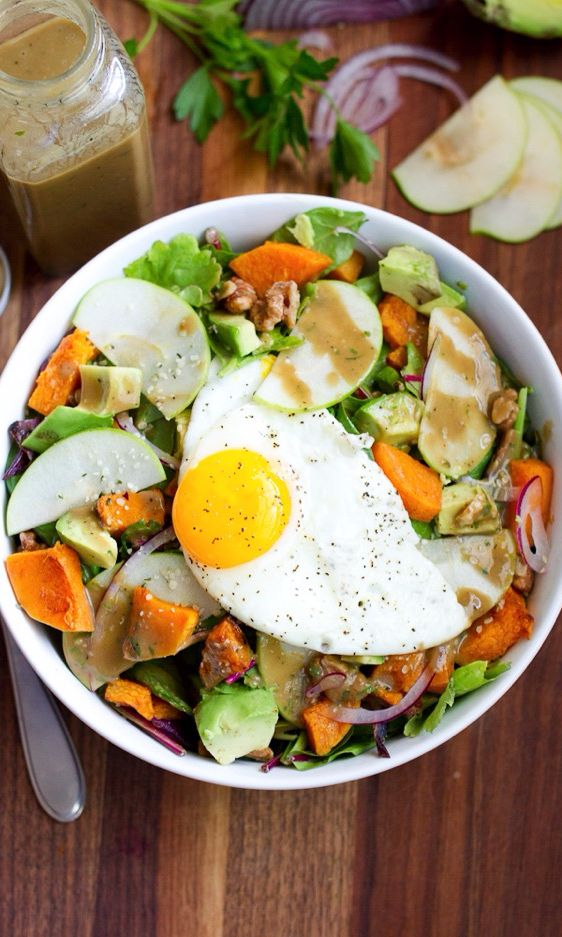 """The warm egg softens the greens a bit and the yolk added a bit of """"dressing"""" — it will be delightful and totally instagram-worthy."""
