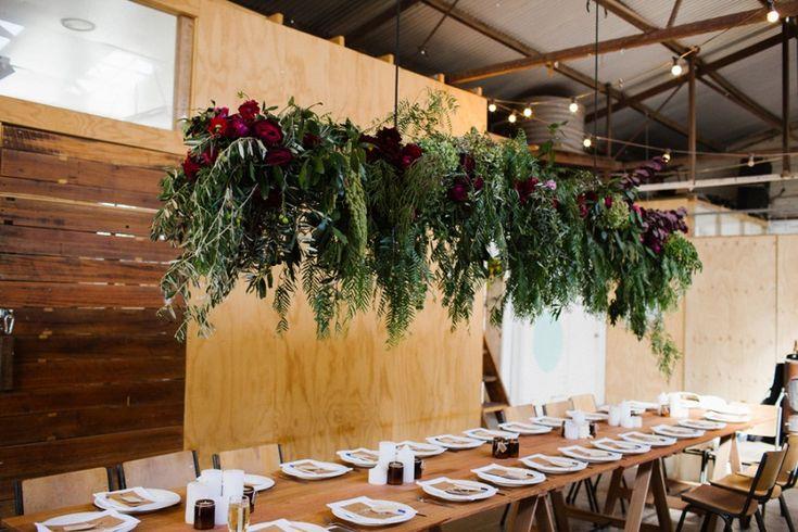 Floral + foliage chandelier > Industrial Melbourne wedding at Pop & Scott Workshop | Photography by Kate Pardey