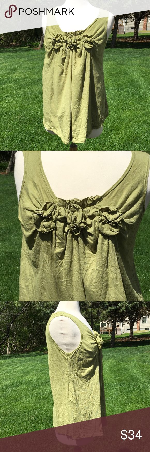 Chalet Crinkled Tank Top Soft, lightweight, crinkled design with 3 rosette details along front neckline. Loose fitting, flowy at the bottom. Care tag has been removed. Excellent condition, worn once. Chalet (Boutique Brand) Tops Tank Tops