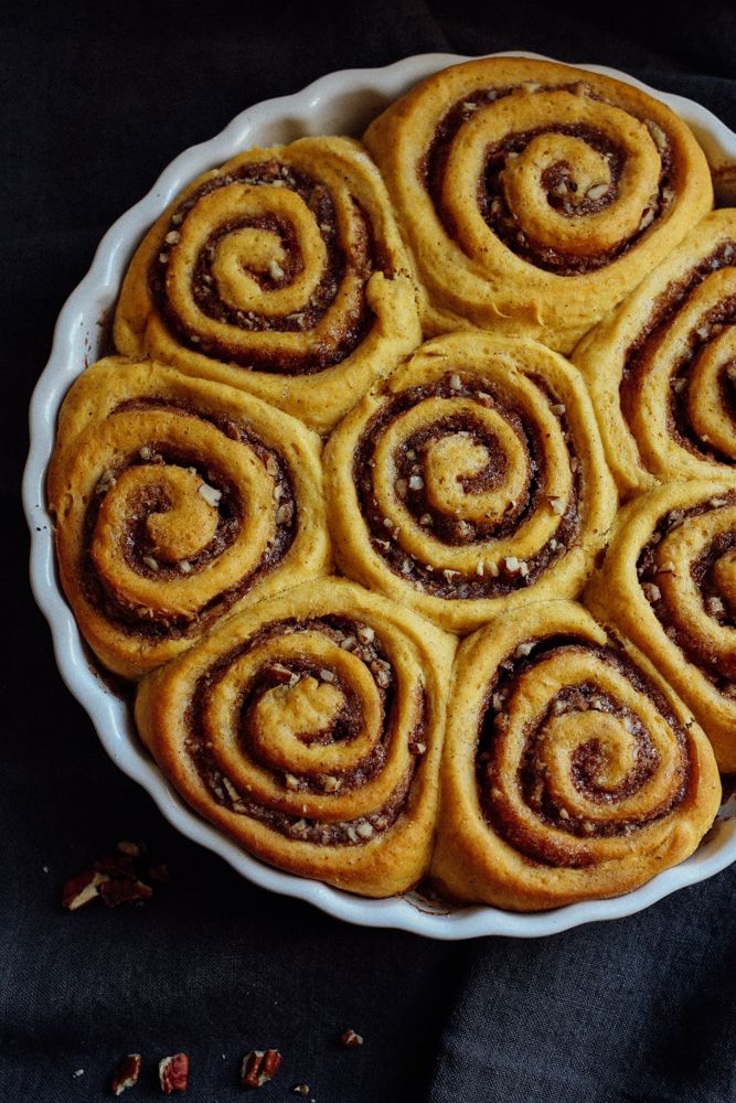 Sweet Potato Cinnamon Rolls Recipe by The Wood and Spoon Blog. Sweet and lightly spiced sweet potato buns rolled with chopped pecans, brown sugars, and warm fall-flavored spices. These are perfect for breakfast and sweet enough for dessert. Topped with a cream cheese frosting.