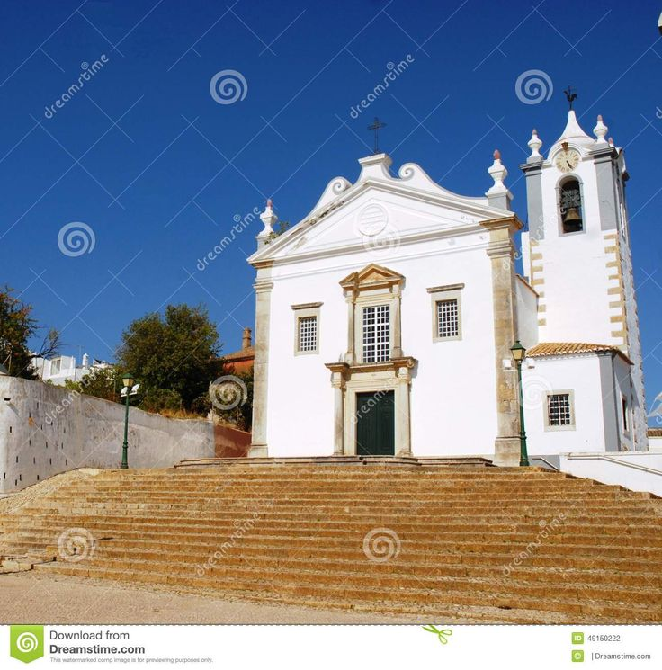 Estoy in Portogallo.Estoy in Portugal. Photos of the main church of the town. Church small and simple but its color predominantly white, which goes well with the color of the broad flight of steps, and the contrast with the blue color of the sky, make the mmagine beautiful.