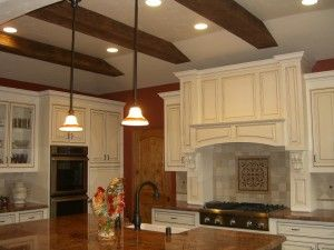 Amazing Kitchen With White Cabinet And Ornamental Lights