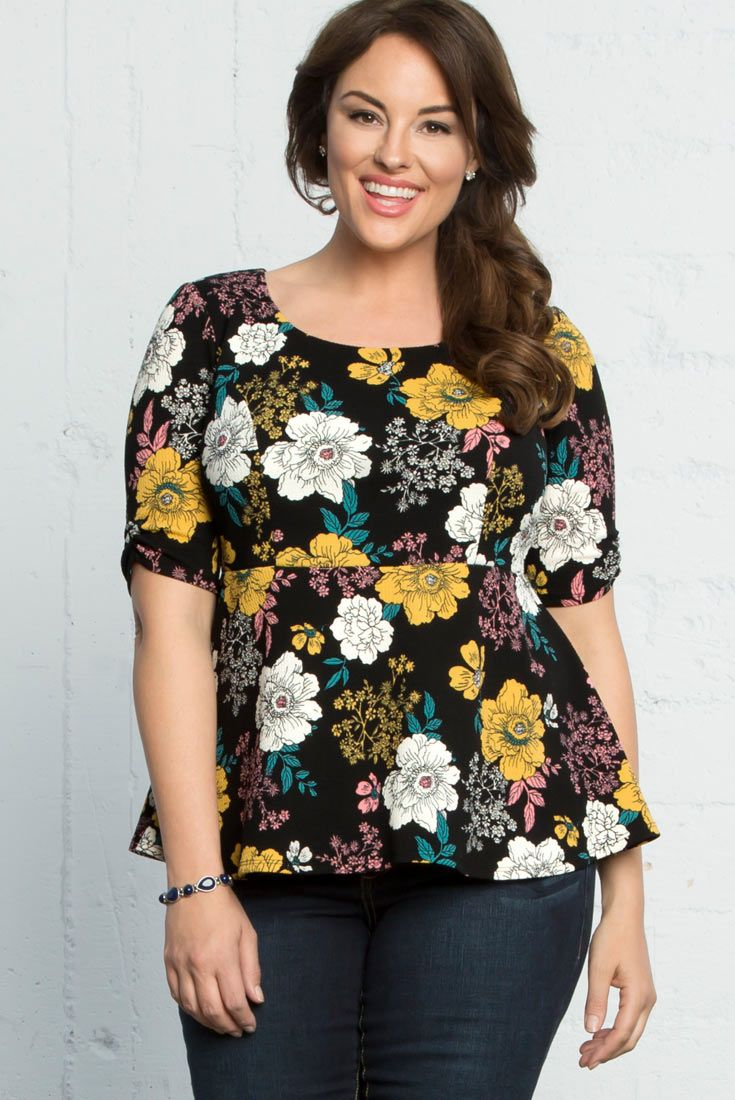 Our plus size Penny Peplum Top should be in your work week rotation. Our floral print can easily be paired with black dress pants or a skirt. Pair it with your favorite blazer. Made in the USA. www.kiyonna.com