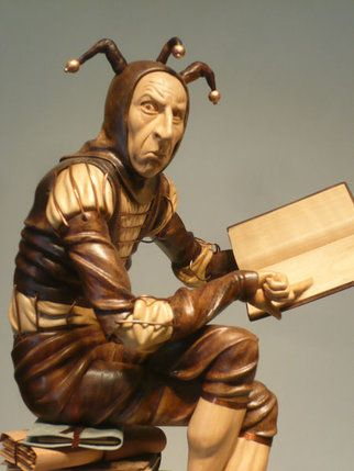 'The Bureaucrat' - by Ian Norbury;  carvedin walnut, limewood, pear, with patinated copper, various veneers & marble;  21 inches tall, including base