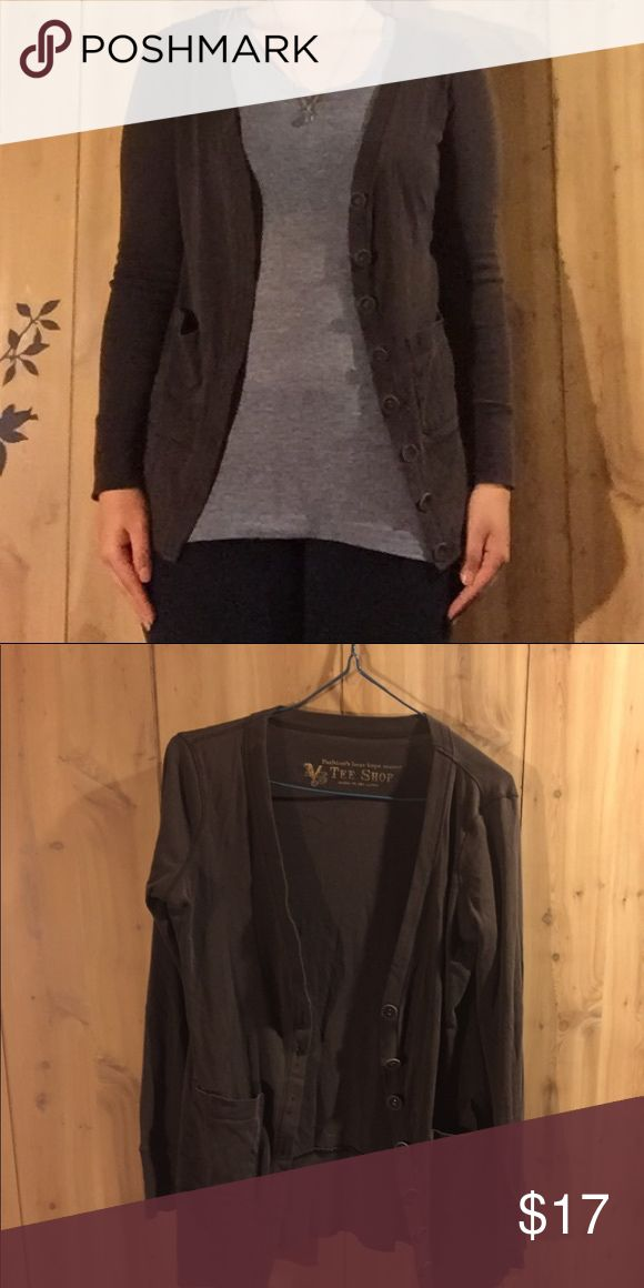 A dark brown Tee Shop Cardigan It is a very nice cardigan, it looks nice for both business and casual wear. It also has good material and isn't made of super thin material, providing a little more warmth especially for the winter. It can also work for summer months as it isn't too heavy either. Tee Shop Tops