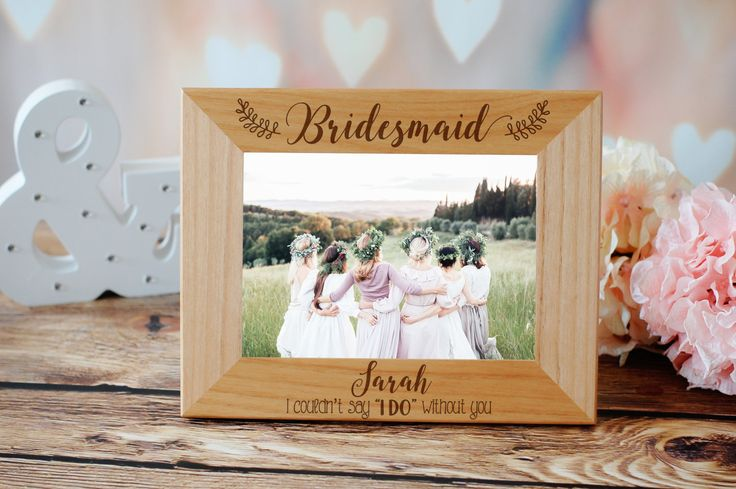Gift your wedding party with a personalized frame they can fill with photos from your big day! | Bridesmaid Picture Frame | Custom Engraved Photo Frame | Bridesmaids Gifts | Bridal Party Gift Ideas | Wedding Party Proposal | Bridesmaid Proposal Gift | Bridesmaids Gift Ideas | #bridesmaids #bridalpartygifts