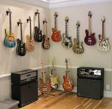 Google Image Result for http://www.rocknrollweekend.com/Guitar%20wall%20in%20office%20-%202.jpg