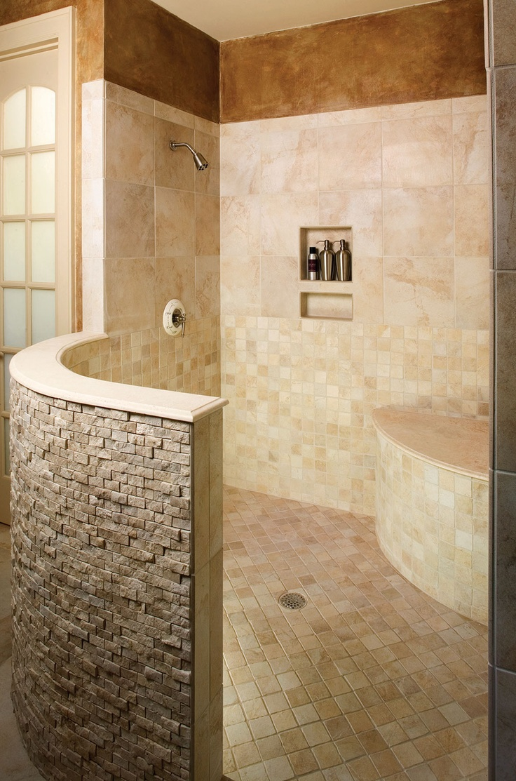 The master bathroom of the Hollowcrest Plan 5019 features a curved, open shower. www.dongardner.com #Shower #Tile #Bathroom