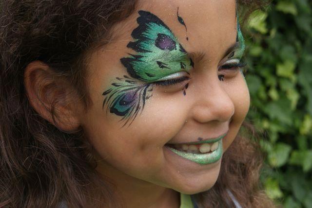 """Peacock butterfly face paint design by Vlinder van Nirjara Honey van """"Honeypot faces""""."""