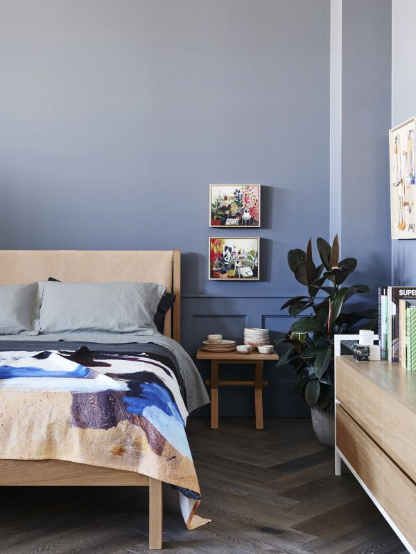 Bedroom details. All furniture by Jardan. Paintings above right hand bedside by Elizabeth Barnett. Ceramics on bedside by Sarah Schembri. Artwork on right hand wall by Kirra Jamison. Bedlinen by Frank and Mint, throw by Shilo Engelbrecht. Flooring – French Grey Herringbone by Royal Oak Floors. Wall colour – Dulux Mirage Blue. Photo – Eve Wilson. www.royaloakfloors.com.au