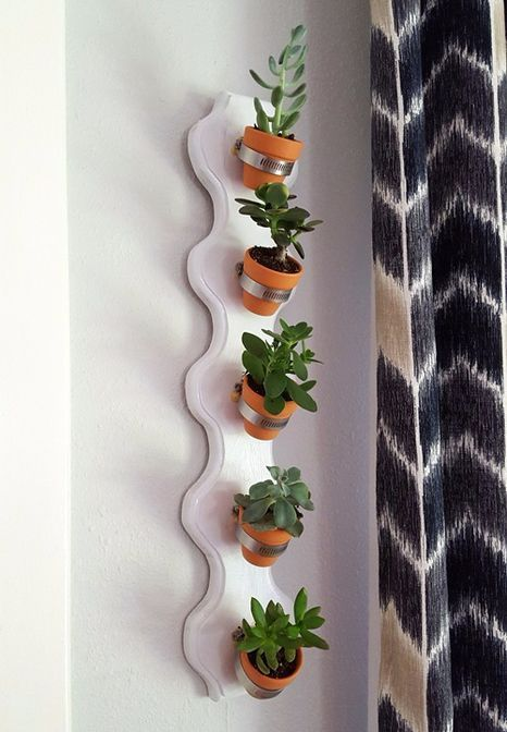 vertical shelf for flowers with their hands
