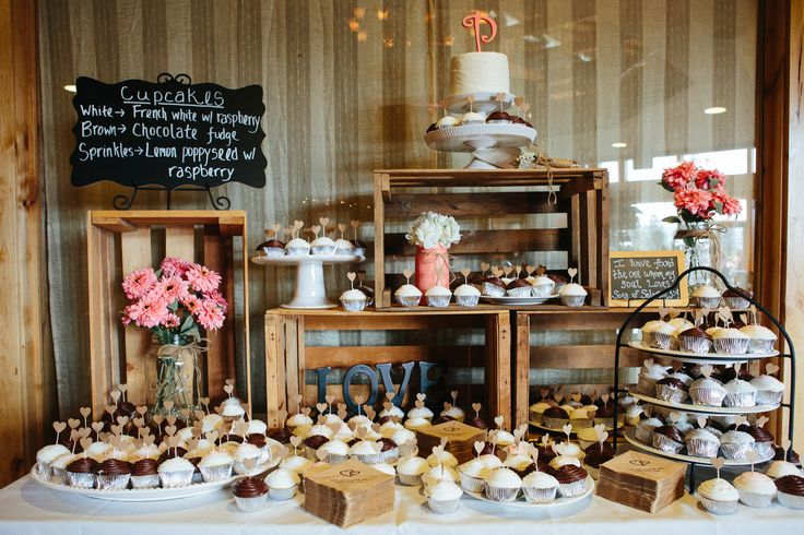 Cupcake arrangements on a variety of different stands were positioned around wooden crates throughout the dessert display. Kellie and Nathan had a single-tier wedding cake accented with a coral topper to cut during the reception.
