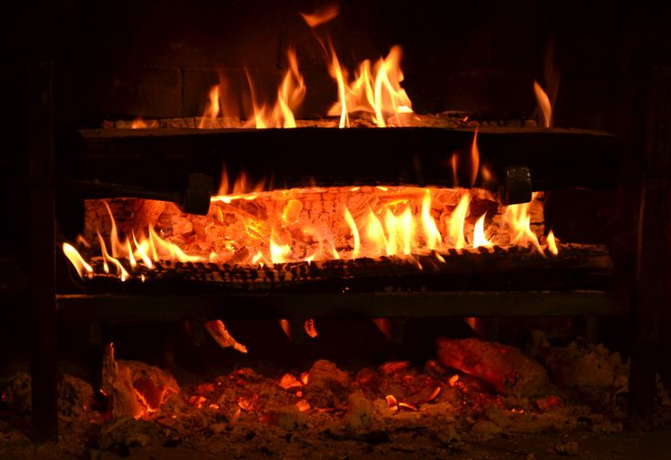 """A beautiful fireplace deserves a smarter fireplace grate. The Texas Fireframe grate opens up the hottest part of the fire to the room. TIME called it """"The Physicist's Fire."""" It's also easy to start and easy to maintain. Our standard size fireplace grate is shown. www.TexasFireframe.com"""