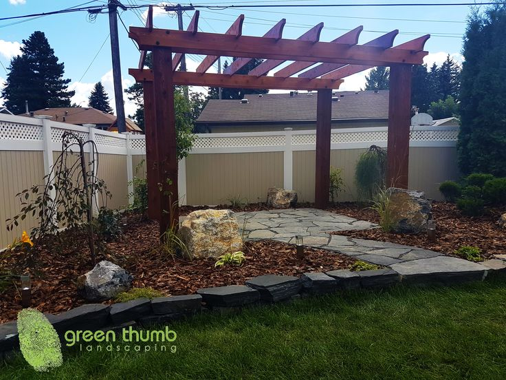 Rundle patio, path, step and garden wall with GT accent boulders, medium bark mulch are a great way to complement your pergola. This combination makes for a great outdoor seating area.