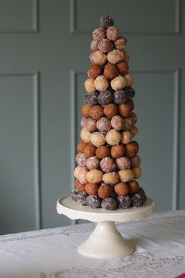 Donut tree: Just follow these simple instructions to make a one of a kind dessert table decoration! Start with a Styrofoam cone in any size. Cover with wax paper and use several toothpicks to hold it in place. Using toothpicks, start adding doughnuts from the bottom up. You can do rows in the same color, or have fun experimenting. Place on a cake stand and you're done!