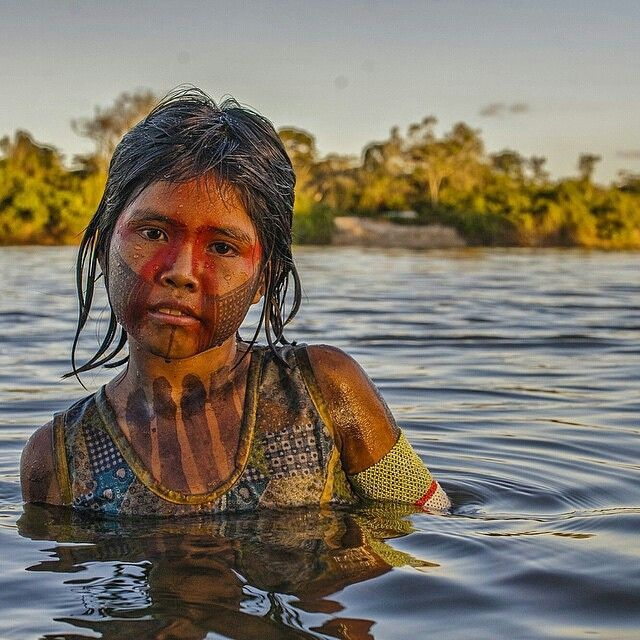 This beautiful Kayapó girl swims in the waters of the mighty Xingú River of the Brazilian Amazon However, by the time the construction of the Belo Monte dam is finished, the Xingú River, which has flown unobstructed on its course to the Amazon River will cease to be.  Let's support @amazonwatch who work to preserve the way of life of these beautiful people  Photo thanks to @cristinamittermeier  #discoversouthamerica