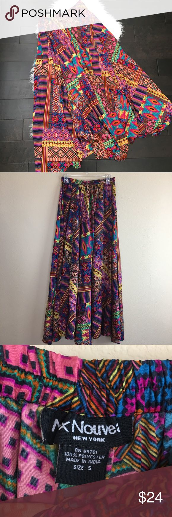 "Mix Nouvea New York Boho Maxi Multi-colored Skirt Mix Nouvea New York Boho Maxi Multi-colored Skirt. Elastic waistband.Size Small  Approximate measurements laying flat  •waistband:13.5"" •length:44"" •condition: Preowned gently used condition Mix Nouvea New York Skirts Maxi"