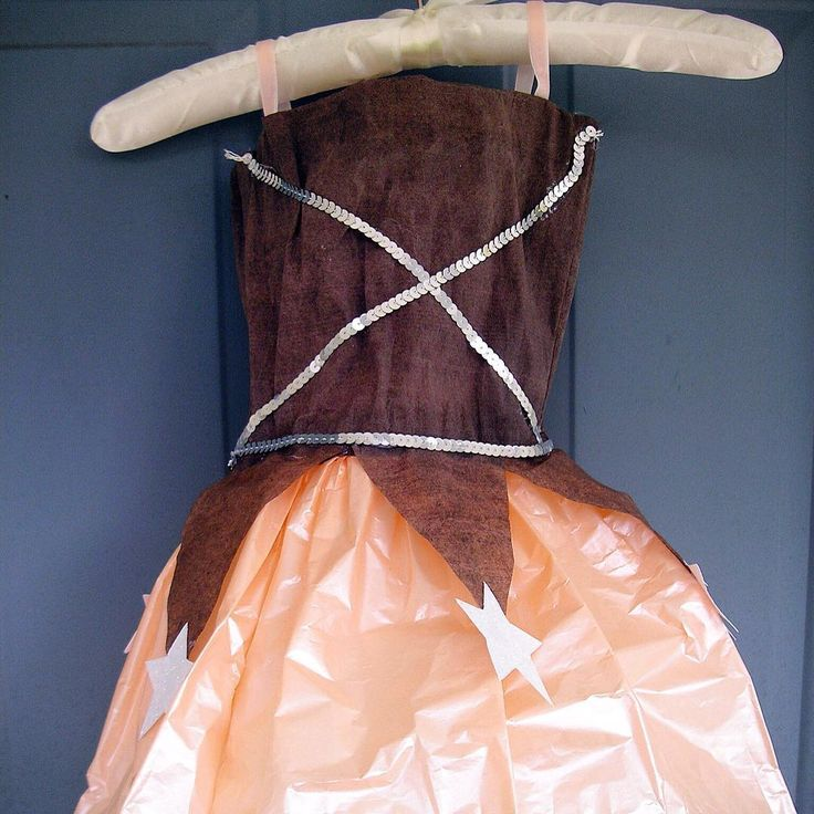 Those days when costumes were made from paper are back. Just grab some Beacon Adhesives Mixed Media Glue, crepe paper, tissue paper, ribbon and sequins! Project coming to blog this week! Don't forget to enter the Beacon Halloween Contest ending Nov.5! Designed by Lisa Kettell #diycostume #crepepaper #vintagestyle @lisakettelldesigns #handmade #diycrafts #mixedmediaglue #beaconhalloween16