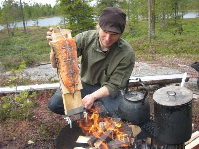 Early summer catch prepared  in wilderness on an open fire, Safartica, Lapland