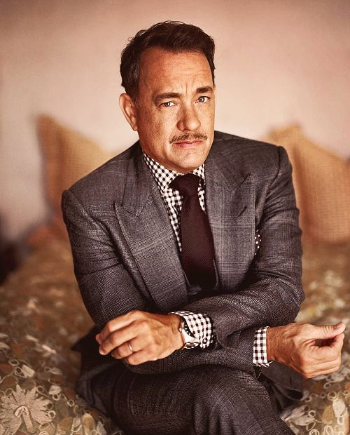 Tom Hanks. Wide grey peak lapel suit