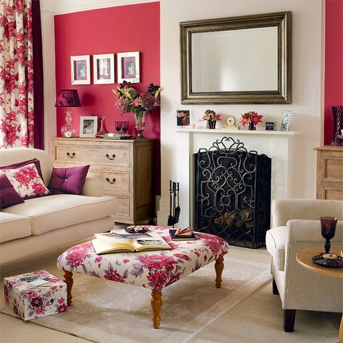 Classic livingroom with bright color walls, neutral furnishings, and floral fabrics tying the bright colors and neutrals together.  The floral curtain panels, ottoman, and pillows give the room a pretty, feminine feel.