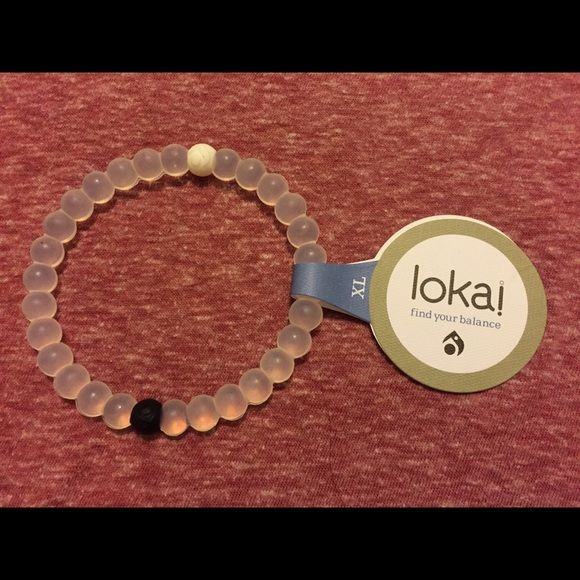 XL Clear Lokai Bracelet! Hi, you're looking at one XL Clear Lokai bracelet. It comes new with tags, never used. I purchased these from a chain of boutiques closing in my area, so I cannot personally verify they are authentic. I cut them open and compared them to real ones and they seem real enough. Still, I don't have the papers so BUY AT YOUR OWN RISK! ***ONCE AGAIN, BEWARE, THIS IS CANNOT BE CONFIRMED AUTHENTIC!*** I am selling them cheap due to this. Next day shipping, thanks! Make a…