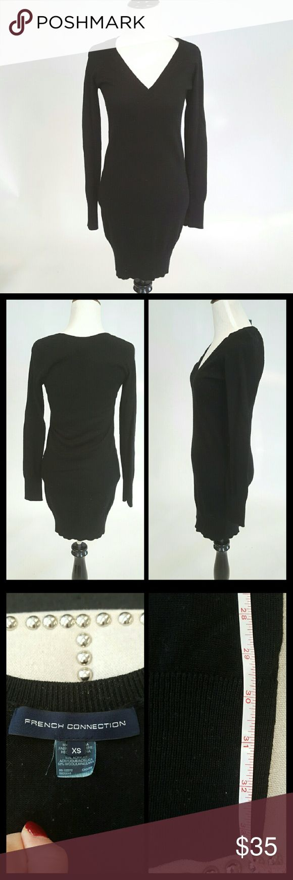 French Connection Sweater dress Slimming jet black, thin v-neck sweater dress in size XS. This was my go to outfit with black leggings and boots. Very flattering and comfy to wear. I wore it with uggs, and dressed it up with heeled boots. Preloved, but  condition. French Connection Dresses