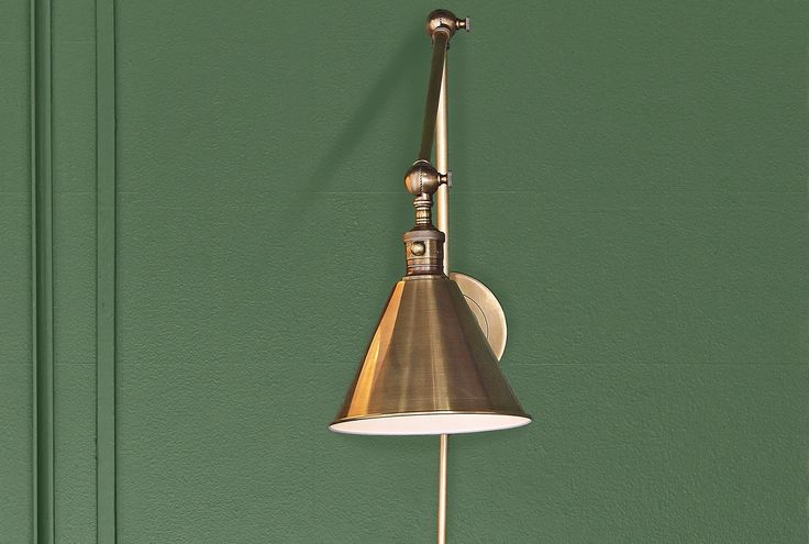 This elegant Boston library sconce is made of antiquated brass and comes with a generous cord cover. $349; Circa Lighting