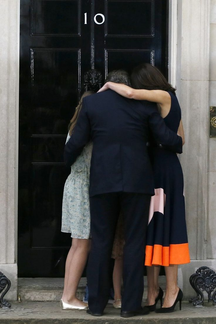 British Prime Minister David Cameron, his wife, Samantha, and their children Nancy, Elwen, and Florence, hug on the steps of 10 Downing Street just minutes after Cameron resigned following a shock defeat in the Brexit referendum.