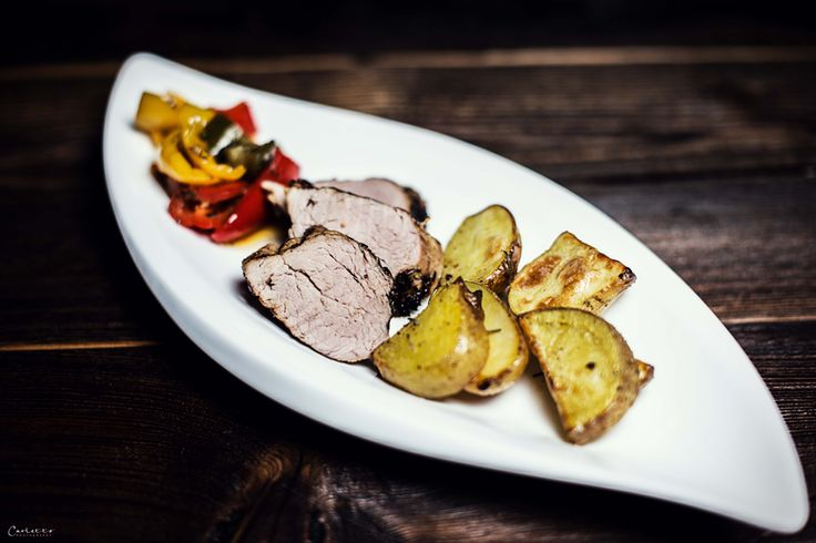 Fine recipe for pork tenderloin fillet with baked potatoes and baked oven vegetables. Easy and quickly ready.