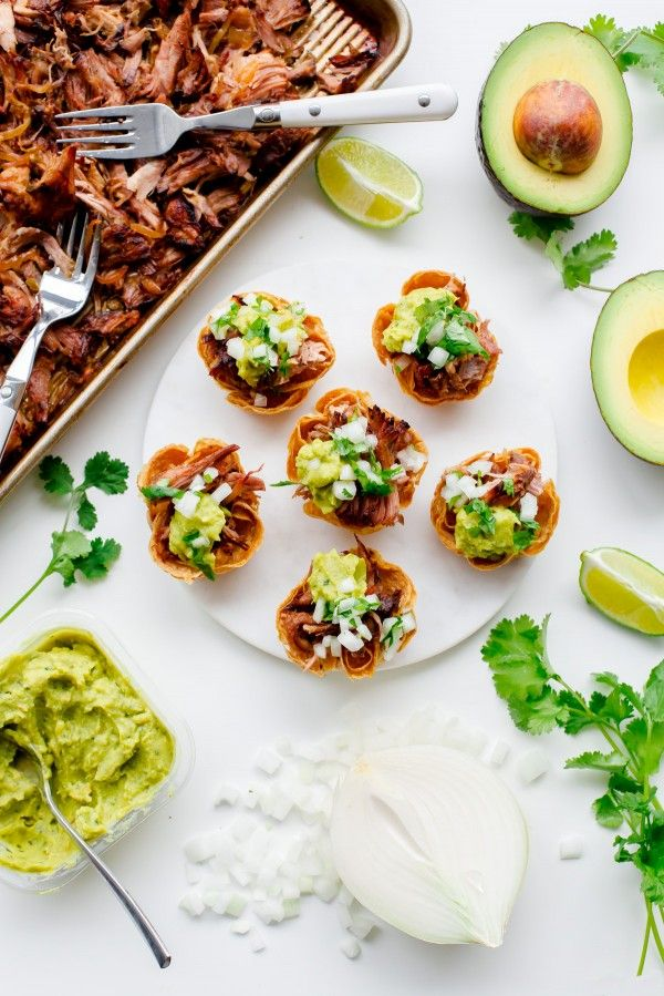 Make your next Taco Tuesday guac-tastic with these Slow Cooker Carnitas Taco Bites.