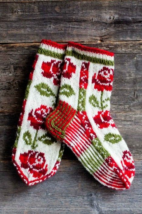 Knitted socks with roses by Tuula Kunnas. Finnish sock contest winner 2012.
