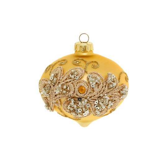Cipolla in vetro giallo oro. Applicazione in rete di pizzo, perline e strass finitura bronzata. Rifinita a mano. Diametro: 10 cm. Venduto X 6.