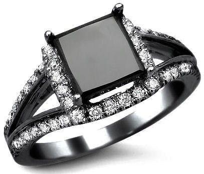 Black Gold & Black Diamond. Stunning. Really digging all of these black diamond and black gold rings