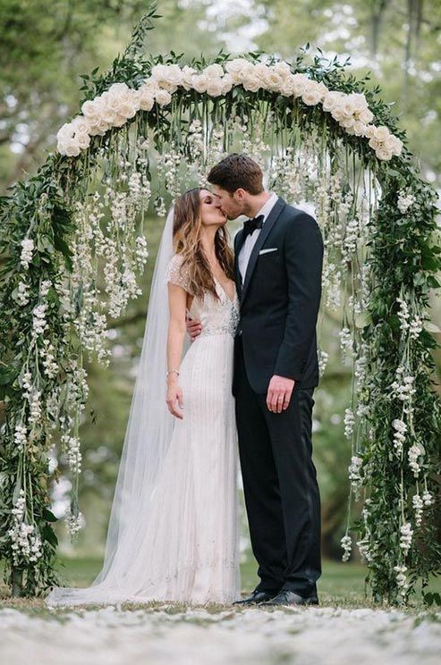 Photographer: Sean Money + Elizabeth Fay; Romantic chic green garland white floral wedding ceremony idea;