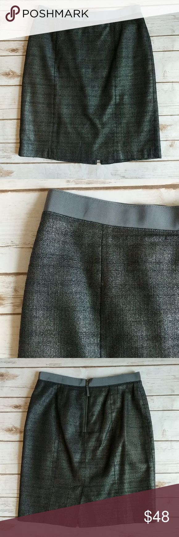 Ann Taylor sparkly metallic gray pencil skirt Simply classic skirt with a 2018 touch of bling! Back zip, ribbon waist band, small back slit. Beautifully lined with a black slip. Bought at Ann Taylor Loft.  Measures: waist 15-15.25 Length 21 Ann Taylor Skirts