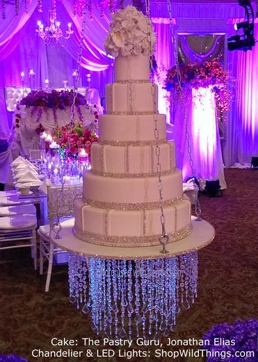 """Suspended Wedding Cake with a """"Dazzle"""" Crystal Chandelier hanging underneath! To. Die. For."""