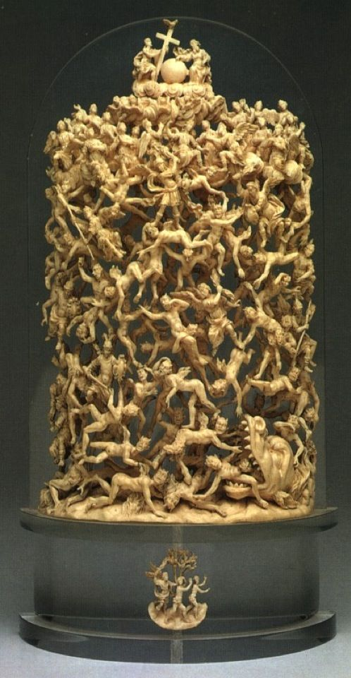 """""""The Fall of the Rebel Angels"""" is carved from a single piece of ivory. Made in Italy in the early 1700s by an unknown artist, it stands nearly a foot tall and depicts the demise of Heaven's rebellious angels into the depths of the netherworld. Notice Adam and Eve clinging to the """"Tree of Knowledge"""" at the bottom."""
