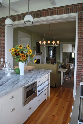 The kitchen flows into an eating and lounge area at P. Allen Smith's Garden Home. Visit www.pallensmith.com for more photos, recipes, and tips.: Recipe, Kitchen Brick, Kitchens Brick, Photo, Design