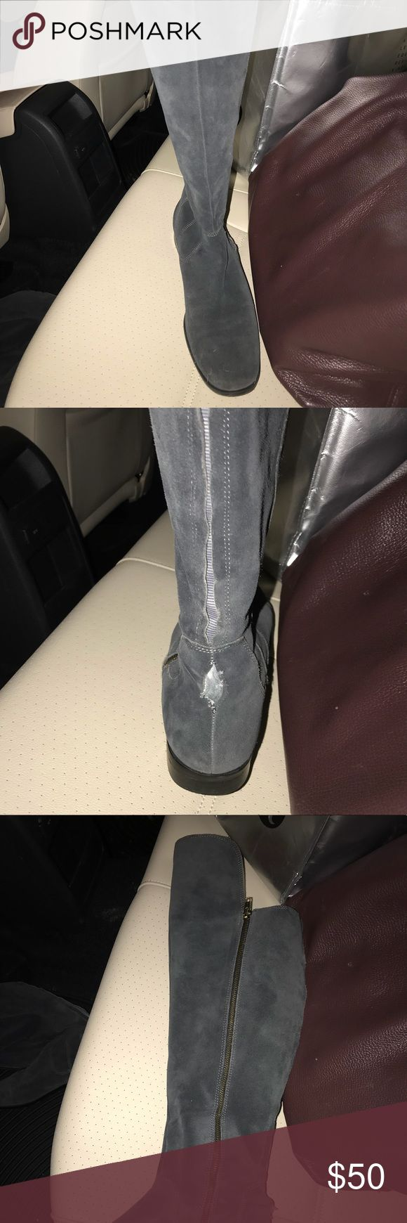 Gray suede flat boots with over knee tab They are in mostly good condition with a small area ( pictured) that the seam has split. Size 7 1/2. Shoes Over the Knee Boots