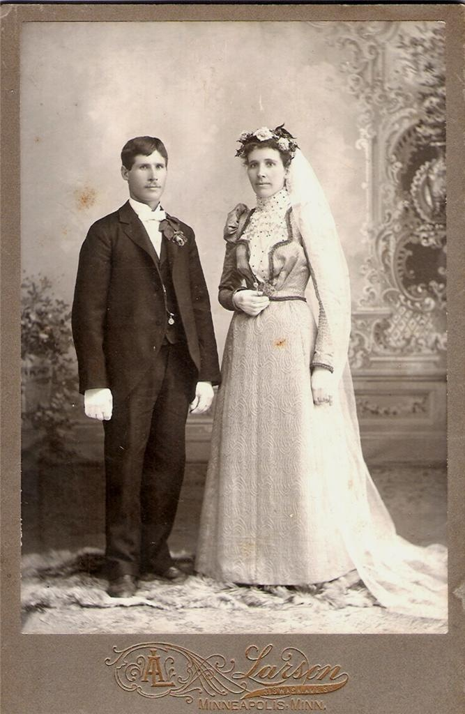 This listing is for a wonderful antique Cabinet Card Photo of a YOUNG  COUPLE in ORNATE VICTORIAN ERA WEDDING ATTIRE taken by PIONEER  PHOTOGRAPHER, ANTON LARSON, at his studio at 313 Washington Ave. South in MINNEAPOLIS, MINNESOTA about 1900.
