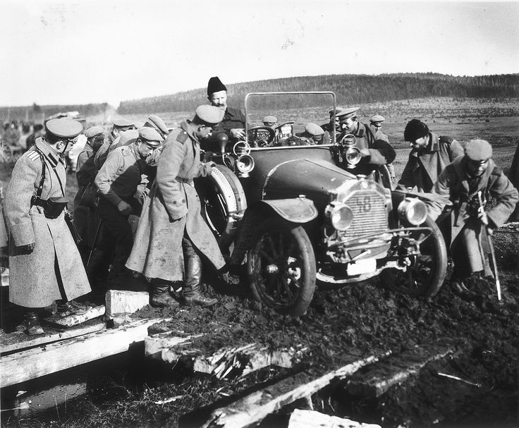 The car of Mr. Mews the Times correspondent being dragged out of the mud by Russian soldiers, 1915