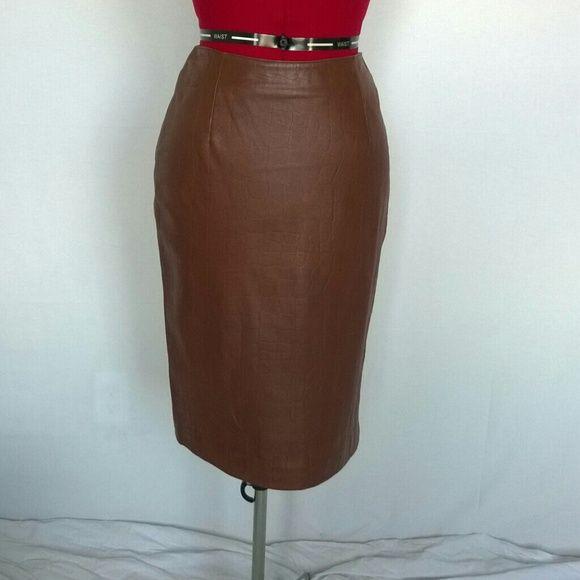 Reddish Brown Leather Skirt NEVER BEEN WORN! Reddish brown leather Skirt with crocodile pattern embossed. Zipper and short slit on the back. Pelle Studios for Wilsons Leather Skirts