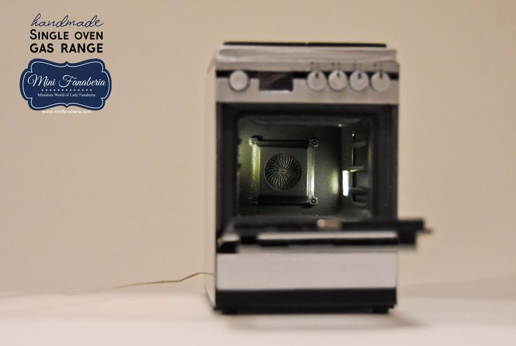 A single oven gas range with opening door, metal hinges, magnet door latch, 2 pull out trays, working lamp, metal cover, gas cooktop with 4 burners and black grate. Entirely made by me in 1:12 scale.