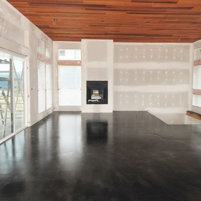 Stained concrete floor... Could do this in a finished basement instead of installing flooring