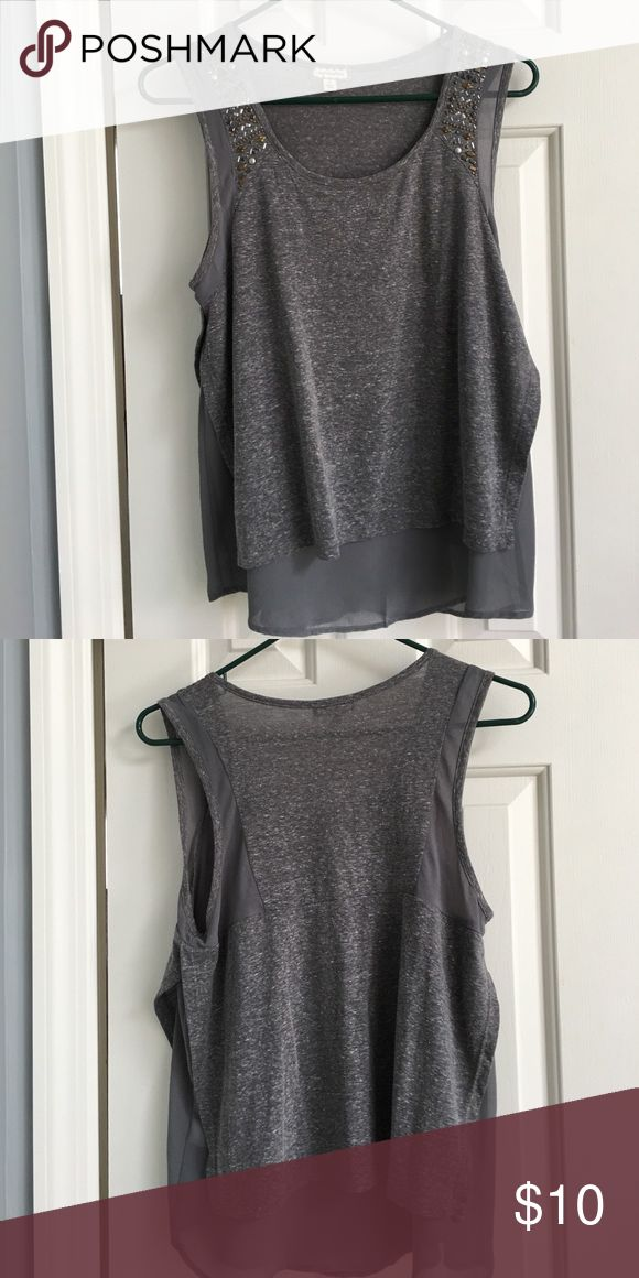 Studded faux layered top. Super soft. What else could you want! This is an awesome soft material! Great on its own or layered for the cooler months! Runs a little big. Loose for a small or a regular medium. Eyeshadow Tops Tank Tops