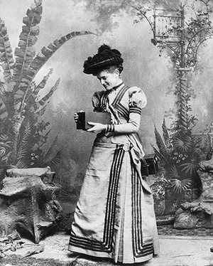 Kodak: 1895: A woman holds an early Kodak camera